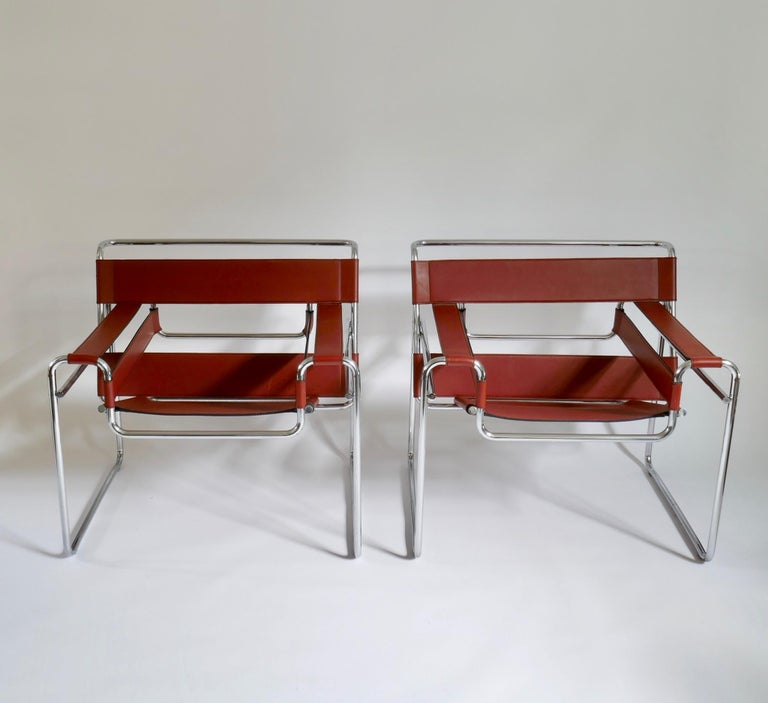 Pair of Marcel Breuer style brown or burgundy leather wassily chairs.