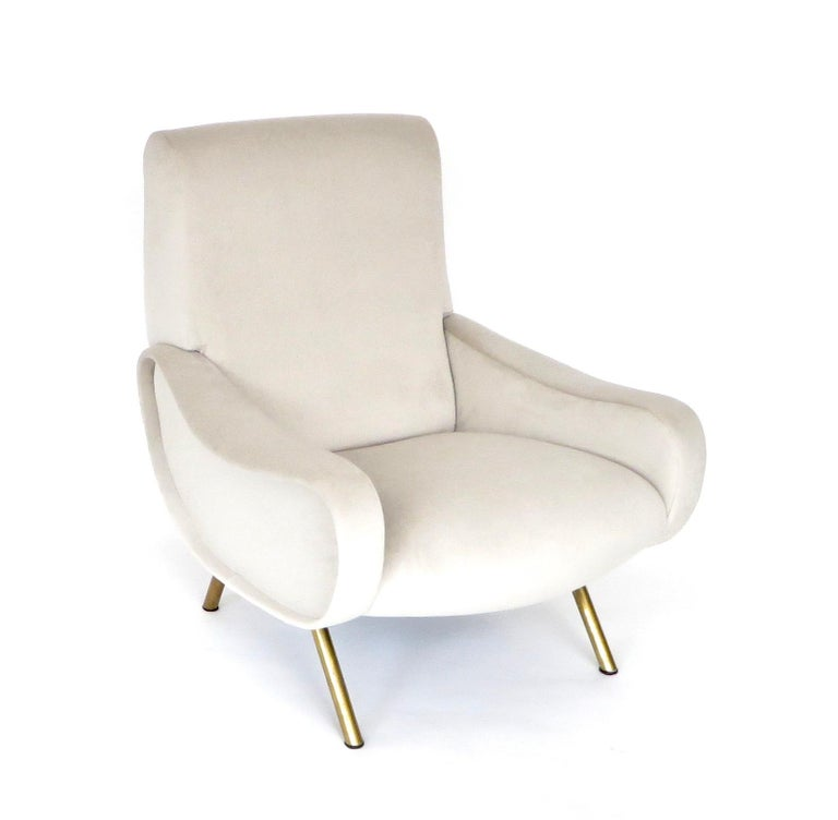 Pair of Marco Zanuso Italian lady chairs for Arflex. The lady chair was designed by Marco Zanuso for Arflex in 1951. It won the award Medaglia d'Oro or Gold Medal at the Milan IX Triennale. Newly restored and reupholstered in pale light cream taupe