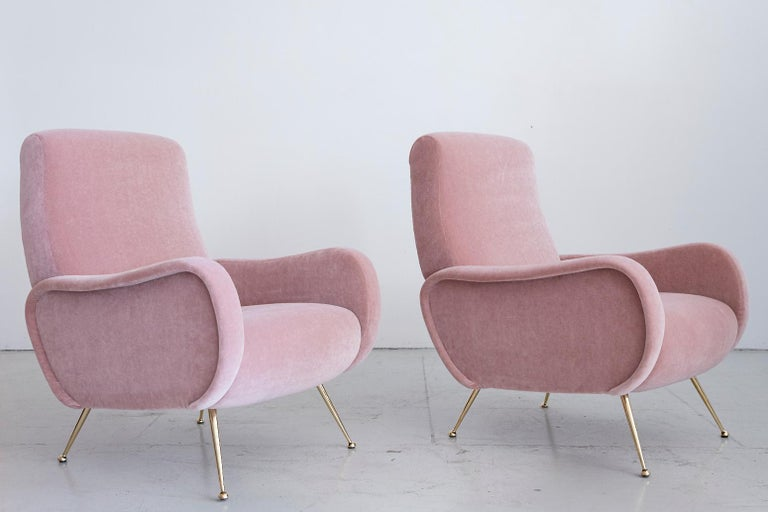 Stunning pair of Italian chairs in the style of the Marco Zanuso lady chair. Newly upholstered in a pink mohair with beautiful sculptural curved shape and newly polished brass tapered legs.