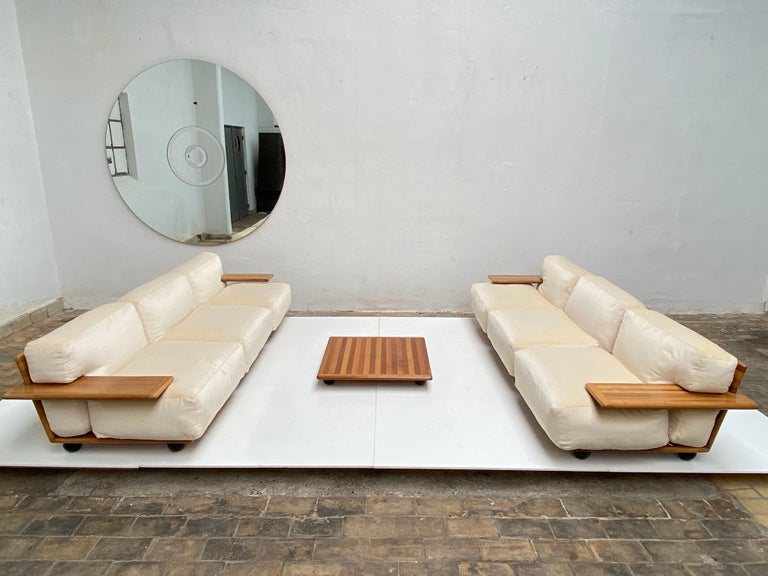A beautiful and rare Mario Bellini 'PIANURA', modular living room set comprising a pair of three seat sofas with the matching 'pianura' coffee table. This is a modular system so you could rearrange the sofas into a four seat sofa and a two seat sofa