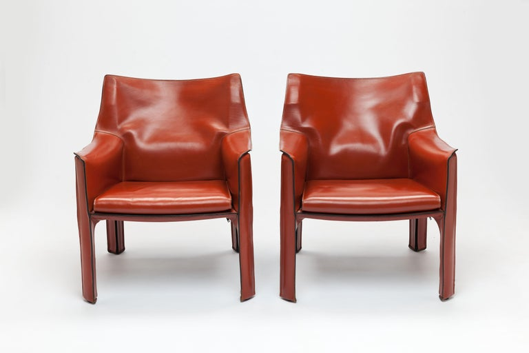 Pair of 1980s model CAB 414 lounge chairs by Mario Bellini for Cassina Italy. Exceptional high-quality chairs consists of a leather cover stretched over a steel frame. Bellini's innovation lay in using zips to fasten the leather cover to its