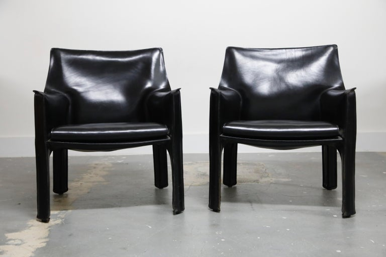 A beautiful pair of Mario Bellini Cab lounge chairs, Model #414, in exemplary condition, signed Cassina, designed in the 1970s. These fine examples of the cab line by Mario Bellini for Cassina are Classic staples for luxury interior designers and