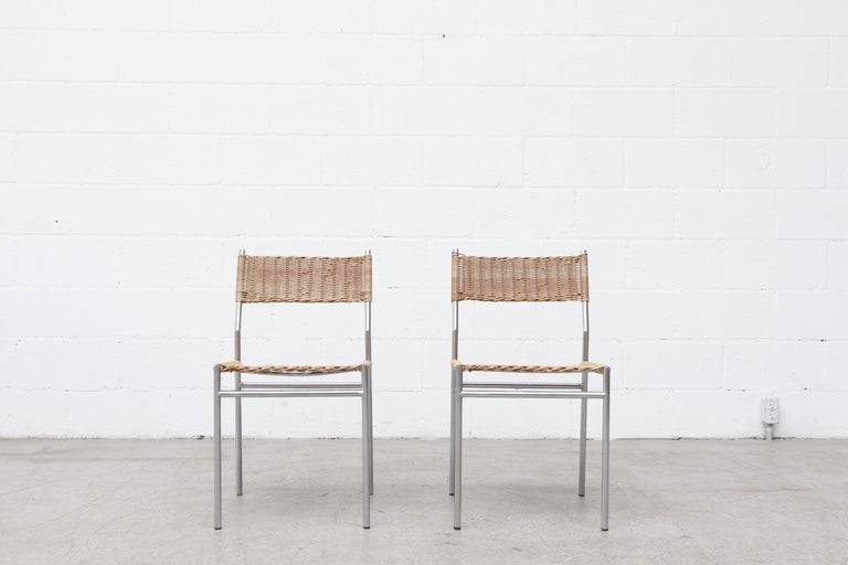 Pair of Martin Visser chrome framed dining chairs with woven wicker seat and backrest. In good original condition with wear consistent with their age and use including some wicker breakage. Set price. A set of 6 is available (LU922421027552) and