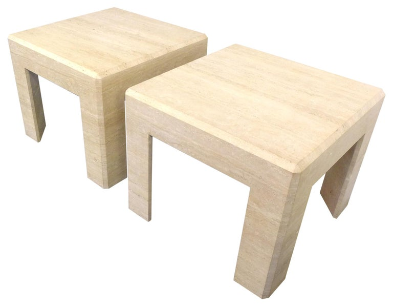 A fantastic pair of travertine side tables. Eye-catching, modern forms of great proportion and subtle detail. Though hollow underneath, mitered travertine slabs built to imply one massive structure with a decorative bevel along the top