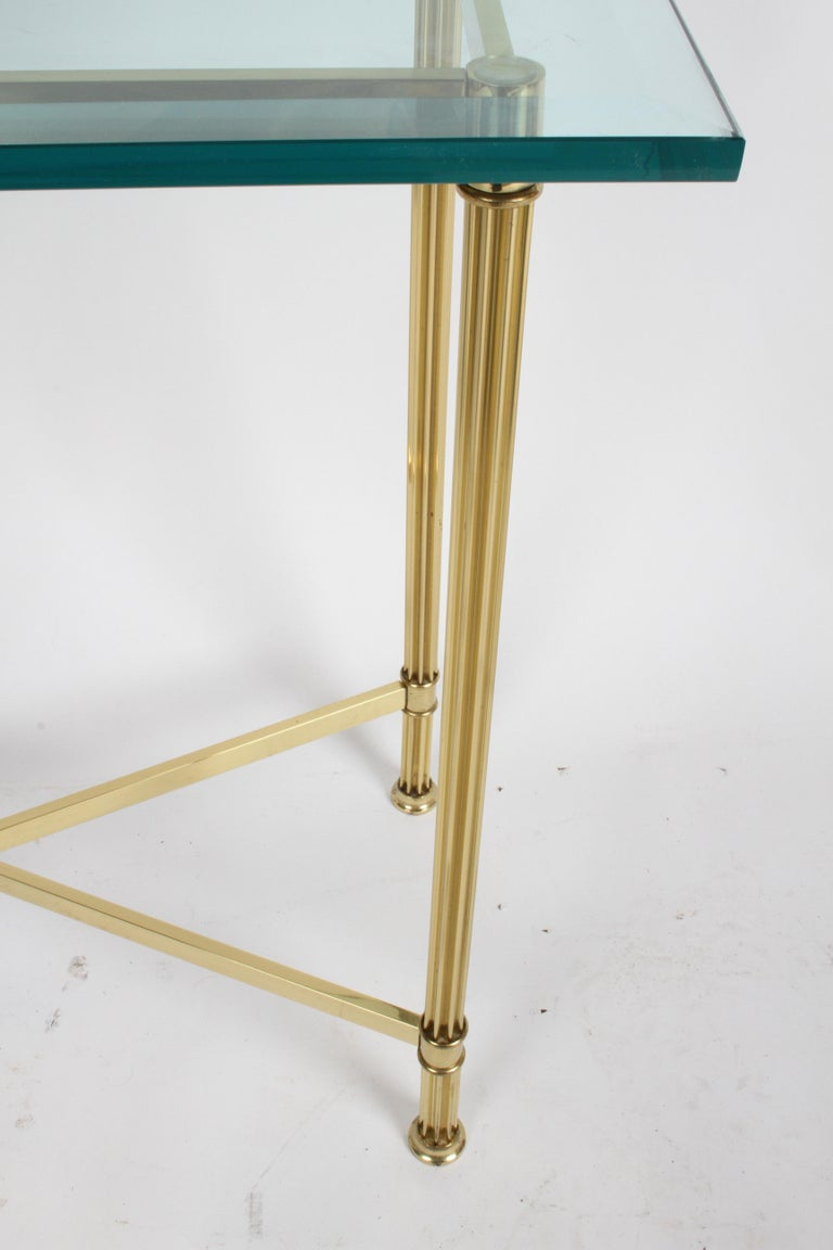 Late 20th Century Pair of Mastercraft Hollywood Regency Fluted Brass and Glass Console Tables For Sale