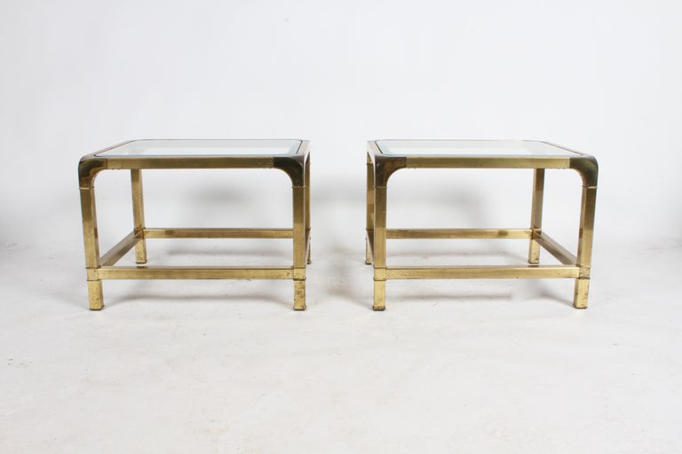 Pair of Mastercraft Asian influenced brass end tables with glass tops. Heavy patina to brass, glass has 1