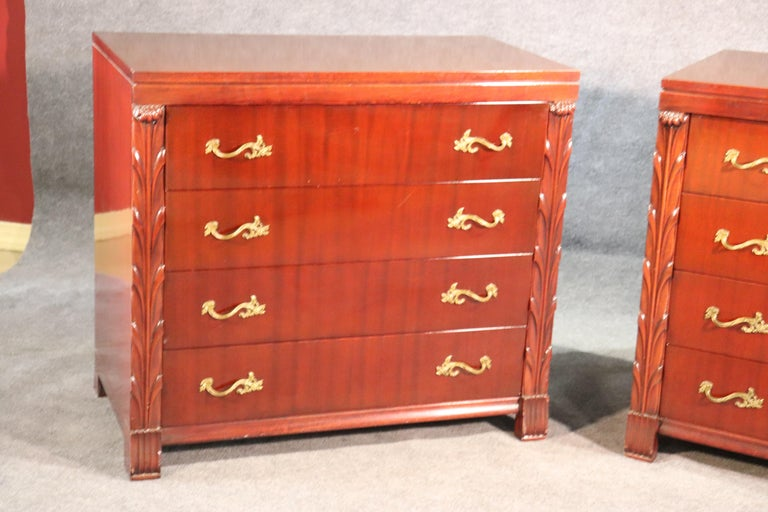 This is a nice paid of John Stuart Hollywood Regency dressers. They are in a red mahogany and not a traditional brown mahogany. They have dovetailed drawers and are in good condition.  They measure 34.5 tall x 38 wide x 20.75 deep.