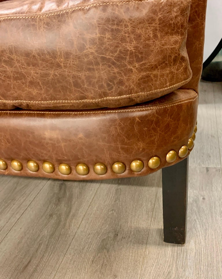 Elegant pair of soft brown saddle leather club chairs with nailheads. Now, more than ever, home is where the heart is.