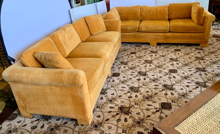 Rare pair of matching coveted signed Century Furniture sofas with original Hermes orange colored velvet fabric. The fabric is original and still in decent condition with normal age appropriate wear. The seats sit a little on the less firm side and
