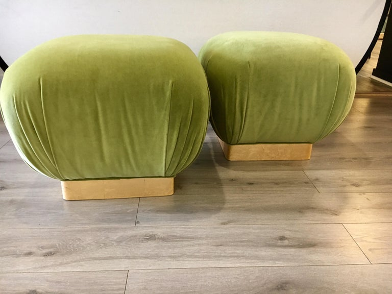 Great looking pair of matching poufs with Milo Baughman style brass banding at bottom. The shade of green on the fabric is vibrant and vivid.