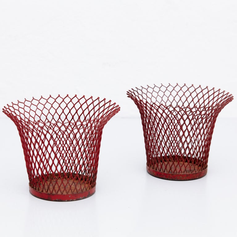 Enameled metal baskets designed by Mathieu Mategot. Manufactured by Ateliers Mategot (France,) circa 1950. Lacquered perforated metal, it has some traces of rust.  We offer free worldwide shipping for this pieces.  In original condition, with wear