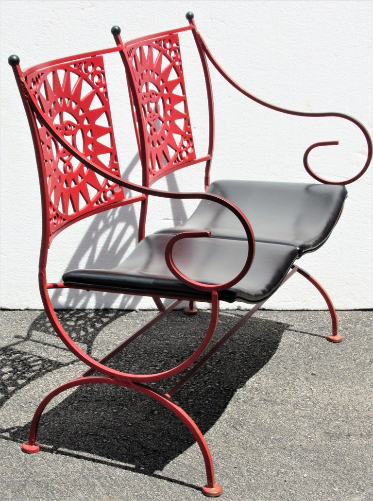 A pair of Mayan Sun two-seat  iron bench settees by Arthur Umanoff for Shaver Howard in the original beautiful vibrant Chinese red factory painted finish and black vinyl contoured seats. A very hard to find set. Being sold as a pair. Look at all