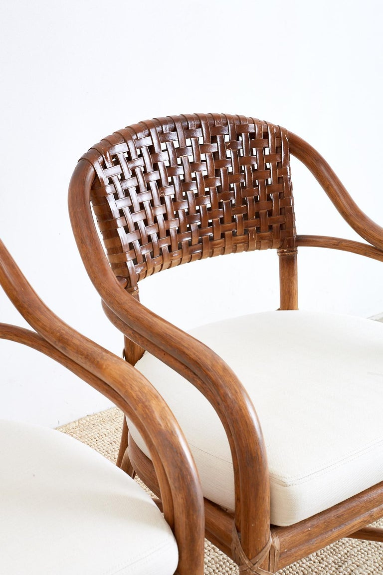 American Pair of McGuire Bamboo and Woven Leather Armchairs