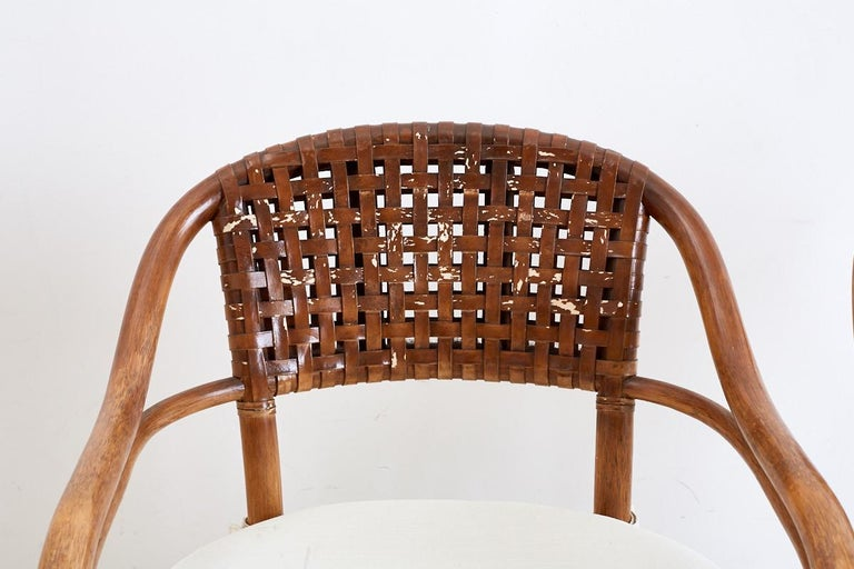 Hand-Crafted Pair of McGuire Bamboo and Woven Leather Armchairs For Sale