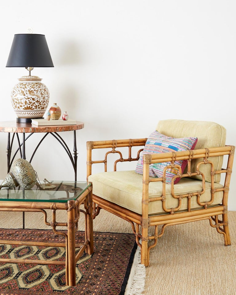 Asian inspired pair of bamboo rattan cube form lounge or club chairs made by McGuire. Created in the California organic modern taste featuring a decorative open fretwork design on the frame known as Marview chairs designed by Elinor McGuire. The