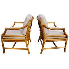 Pair of McGuire Organic Modern Rattan and Leather Upholstered Armchairs