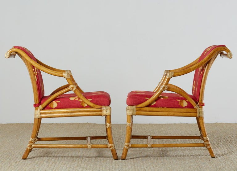 Hand-Crafted Pair of McGuire Rattan and Cane Upholstered Lounge Chairs For Sale