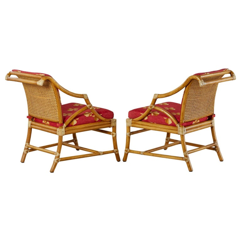 Pair of McGuire Rattan and Cane Upholstered Lounge Chairs For Sale