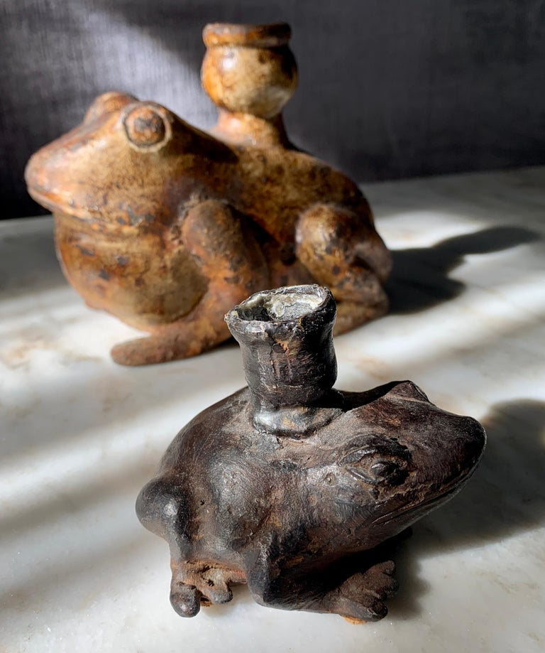 Folk Art Pair of Metal and Bronze Frog Candleholders For Sale