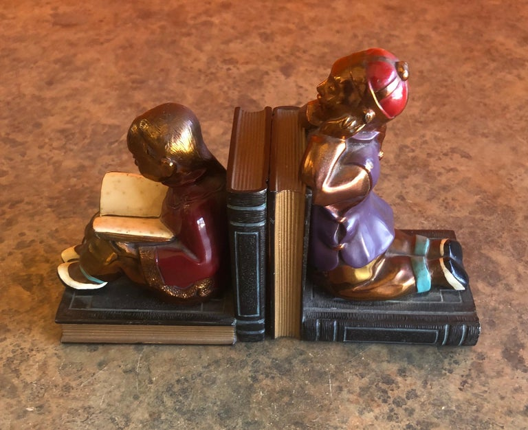 American Pair of Metal Clad Art Deco Bookends by Ronson Art Metal Works For Sale