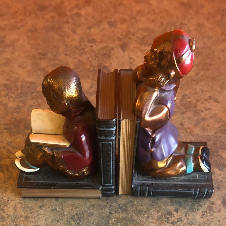 Pair of Metal Clad Art Deco Bookends by Ronson Art Metal Works In Good Condition For Sale In San Diego, CA