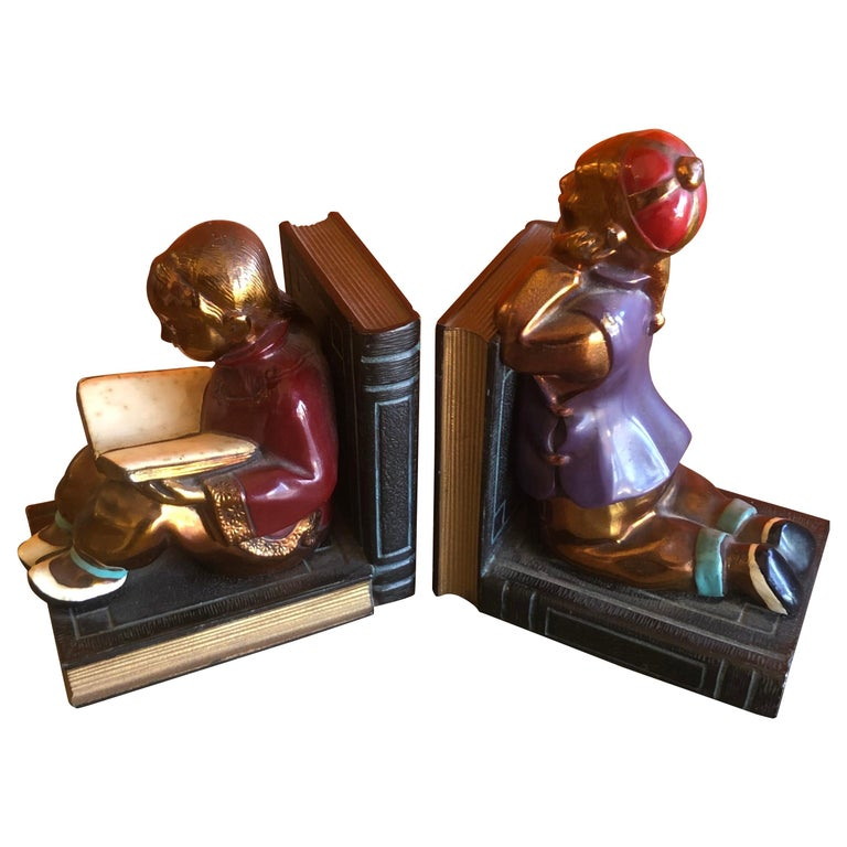 Pair of Metal Clad Art Deco Bookends by Ronson Art Metal Works For Sale