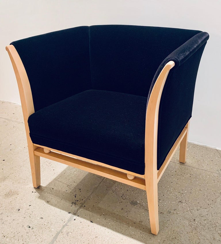 A pair of 1990s Michael Graves for Brayton black shirt mohair upholstery with blond wood club chairs.