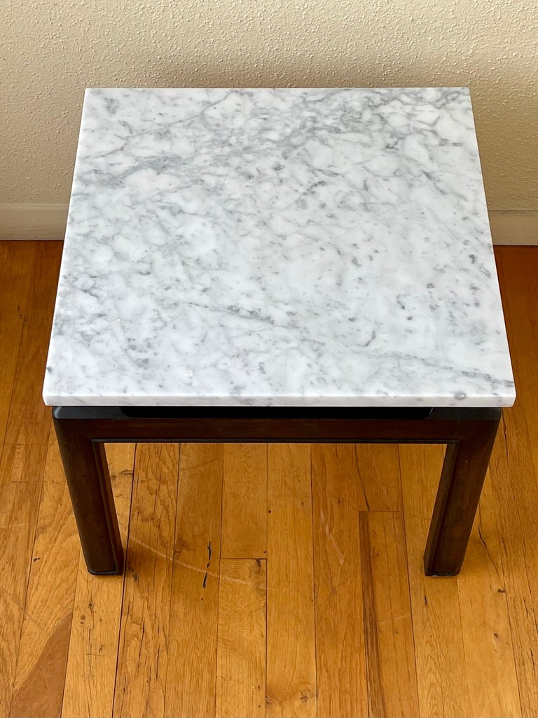 Elegant pair of ebonized solid wood base with solid Italian Marble tops, versatile nice marble tops designed by Michael Taylor for Baker Furniture. easy to move the marble sits on the base that has its original finish in nice and clean condition.