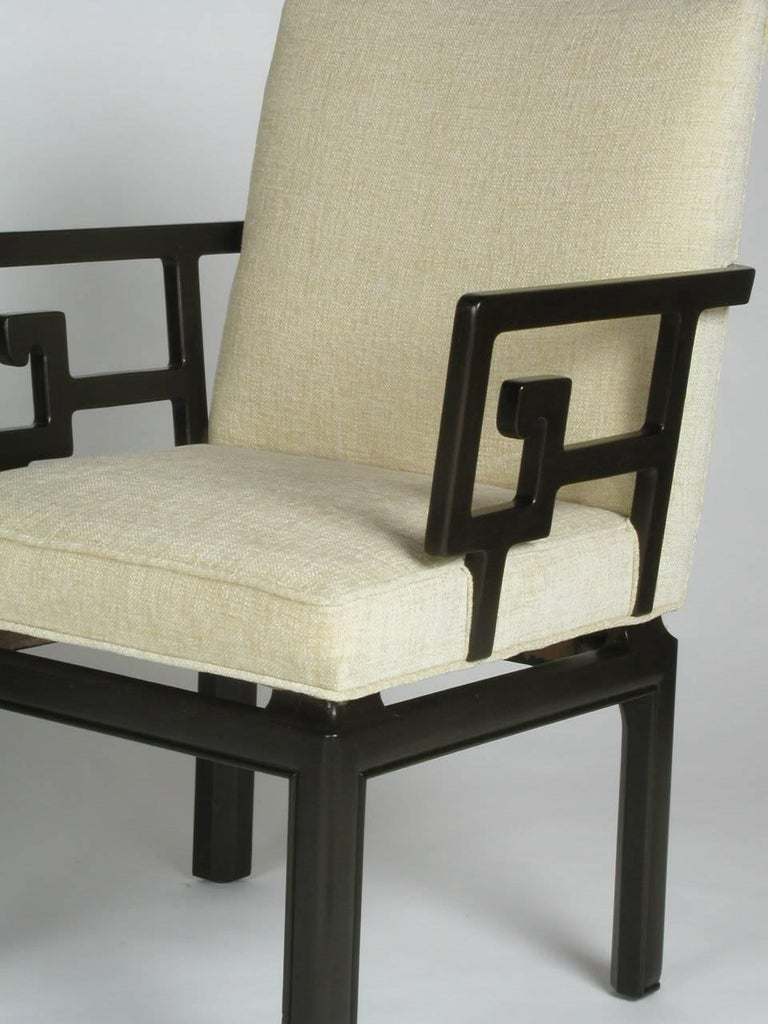 Vintage Michael Taylor Greek key armchairs for his Far East collection by Baker Furniture. In the style of James Mont, with stylized Greek key arms and thick rounded legs. Includes frames refinished. Current set shown is sold, another pair