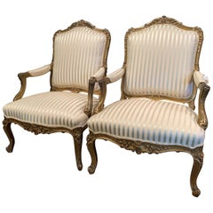 Pair of Mid-19th Century French Louis XV Carved Giltwood Bergères Fauteuils