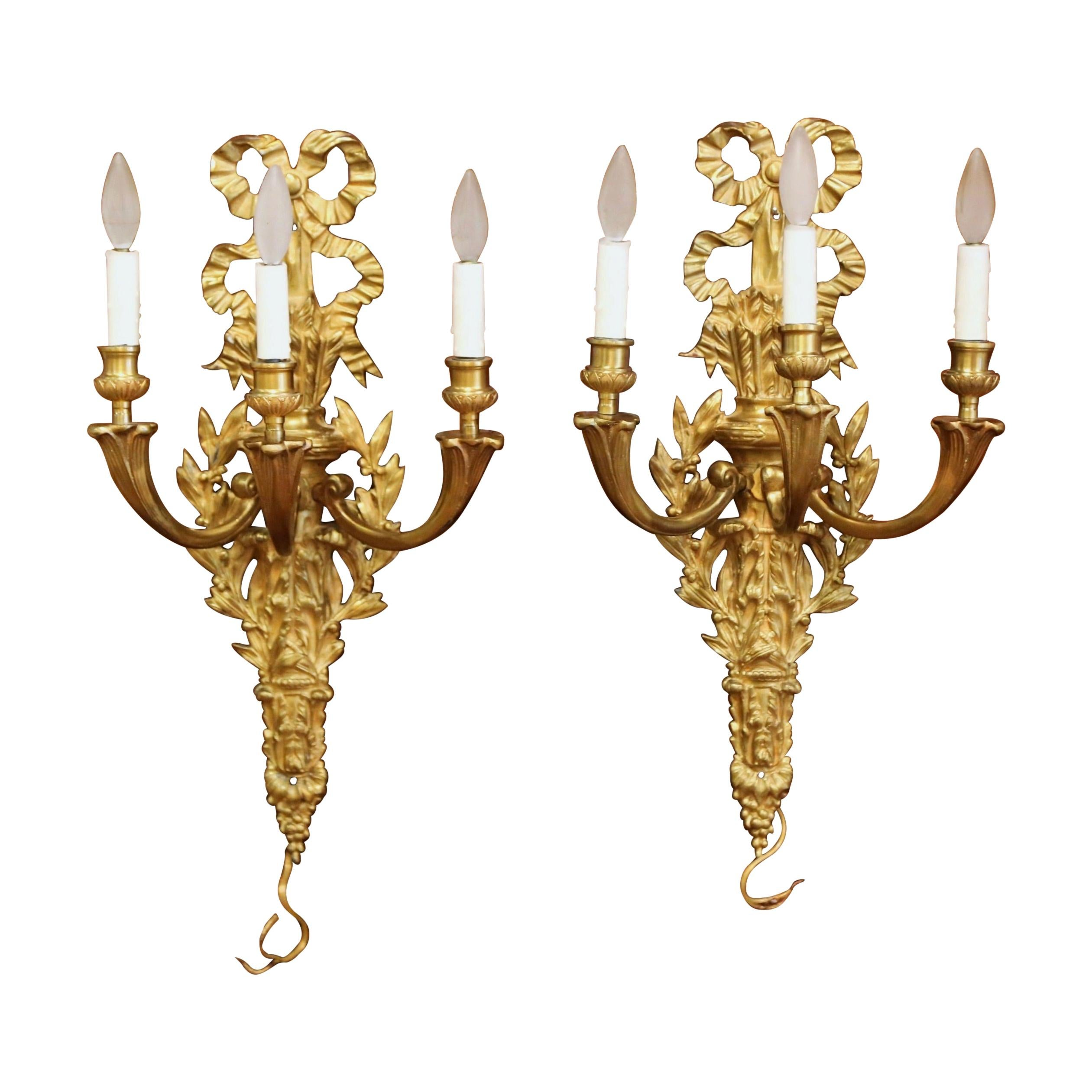 Pair of Mid-19th Century French Louis XVI Bronze Dore Three-Light Wall Sconces