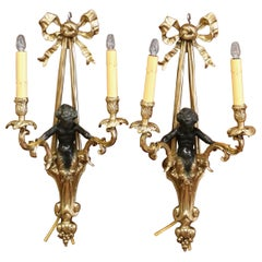 Pair of Mid-19th Century French Louis XVI Bronze Dore Wall Sconces with Cherubs