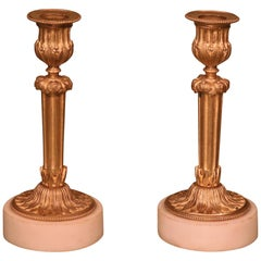 Pair of Mid-19th Century French Ormolu Candlesticks on White Marble Plinths