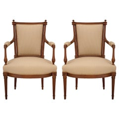 Pair of Mid 19th Century Louis XVI St. Walnut Armchairs