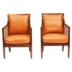 Pair of Mid-19th Century Regency Mahogany Caned Bergère