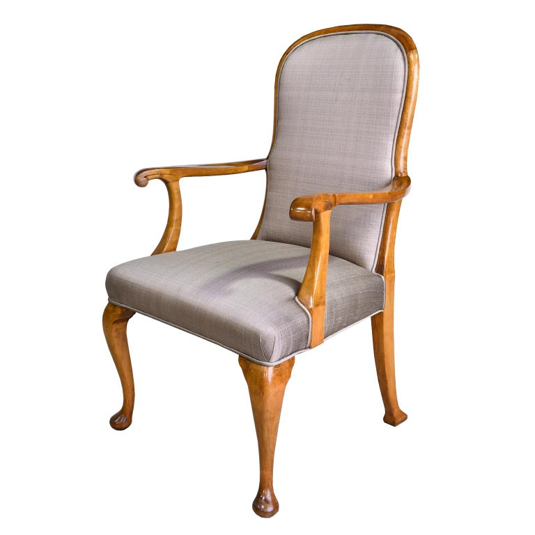 A handsome pair of dining or salon armchairs with birchwood frames, high rounded backs and cabriole legs with pad feet. Chairs are upholstered in a taupe-colored silk blend. England, circa 1930. Very comfortable and sturdy! A set of 10 matching