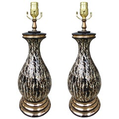 Pair of Mid-20th Century Black and Gold Glazed Pottery Lamps, circa 1950s-1960s