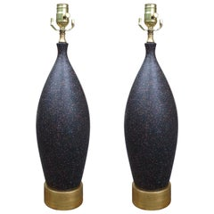 Pair of Mid-20th Century Black Pottery Lamps on Custom Gilt Bases