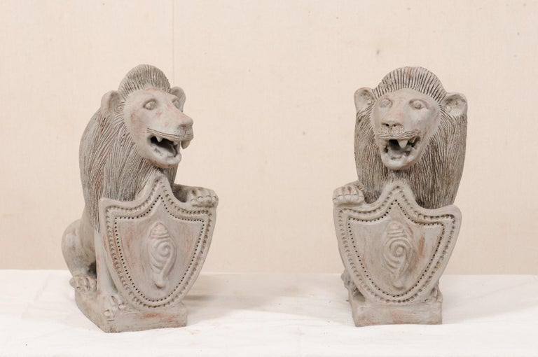 Indian Pair of Mid-20th Century British Colonial Shielded Terracotta Lions For Sale