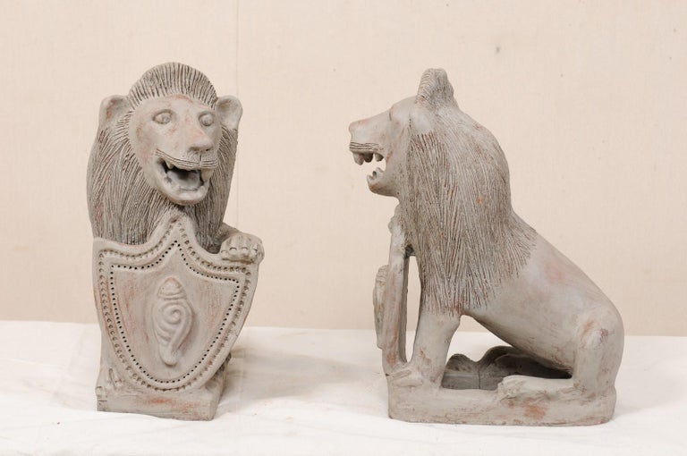 Painted Pair of Mid-20th Century British Colonial Shielded Terracotta Lions For Sale