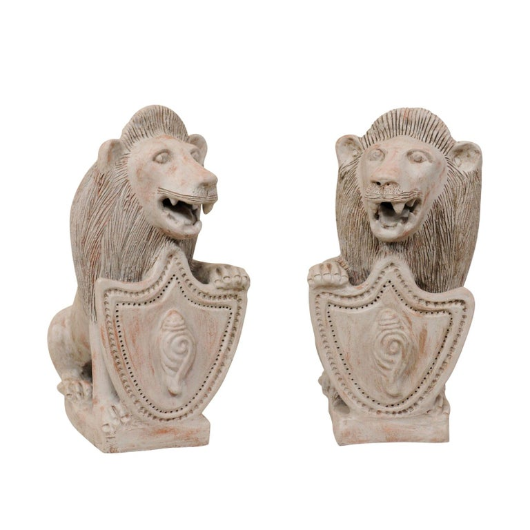 Pair of Mid-20th Century British Colonial Shielded Terracotta Lions For Sale