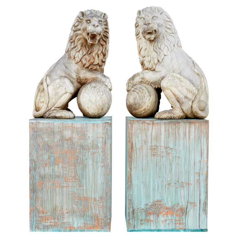 Pair of Mid-20th Century Carved Solid Wood Lions For Sale