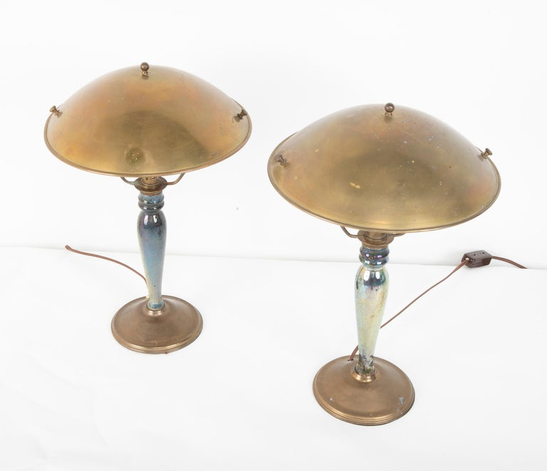 A pair of mid-20th century French blue/green irradecant glazed earthenware lamps with metal shades. The base having VF Deposit written on them.