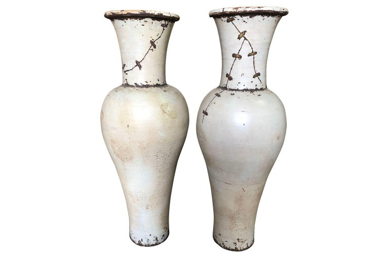 A fabulous pair of grand scale mid-20th century glazed ceramic vases from the South of France. Elegant minimalist lines with wonderful metal detailing.