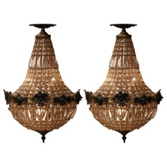 Pair of Mid-20th Century French Crystal and Bronze Four-Light Basket Chandeliers