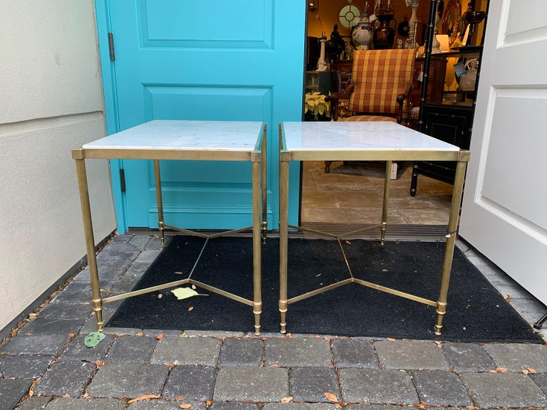 Pair of mid-20th century Italian brass side tables, marble tops, circa 1950s.