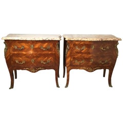 Pair of Mid-20th Century Marble Top Bombe Inlaid Two Drawer Chests with Ormolu