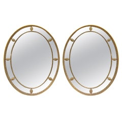 Pair of Mid-20th Century Oval Giltwood George III Style Oval Mirrors circa 1970s
