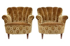 Pair of mid 20th century shell back lounge armchairs