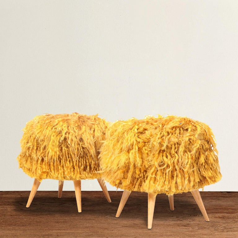 A pair of mid-20th century American stools with turned beech legs, and upholstered in shaggy vintage Turkish goldenrod Angora Tulu rugs.